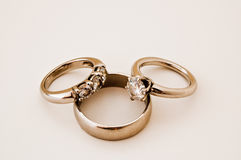 Wedding Bands and Engagement Ring. A Pair of Platinum Wedding Bands and Engagement Ring Stock Images