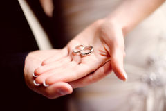 Wedding Bands in Hand. Happy Bride and Groom Holding wedding bands stock images