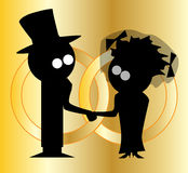 Wedding Bands. Silhouette of a cartoon bride and groom with wedding rings Royalty Free Stock Images