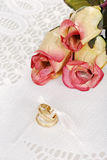 Wedding bands with three roses Stock Images