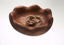 Wedding bands on wooden base Stock Image
