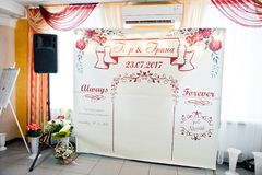 Wedding banner in the restaurant with name initials of newlyweds Stock Photos