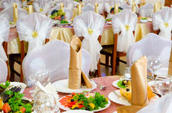 Wedding banquet. Restaurant tables laid for a wedding banquet Stock Images