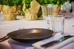 Flowers on a banquet table with empty dishes royalty free stock photo