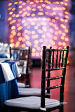 Wedding. Banquet. The chairs and table for guests, served with cutlery and crockery and covered with a blue tablecloth. Wedding. Banquet. The chairs and table Stock Photography