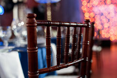 Wedding. Banquet. The chairs and table for guests, served with cutlery and crockery and covered with a blue tablecloth. Wedding. Banquet. The chairs and table Stock Images