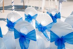 Wedding banquet chairs in white and blue them, Cone of rose petals. The chairs for the guest at beach wedding venue Stock Image