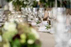Wedding Banquet or gala dinner. The chairs and table for guests, served with cutlery and crockery. Covered with a linen. Tablecloth runner. party on terrace stock photo