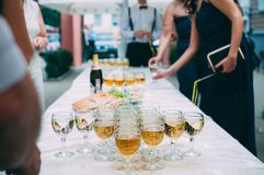 Wedding banquet. Glasses of champagne and people at the wedding banquet stock photo
