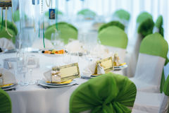 Wedding banquet hall decoration with postcards and green element Stock Photo
