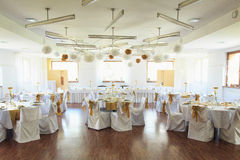 Wedding banquet. Wedding ornated tables, chairs,  white  table-cloth Stock Image