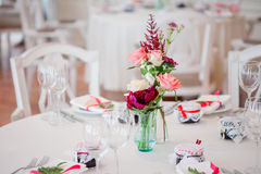 Wedding Banquet, Small Restaurant. Floral Decor In Red, Informal Style.
