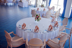 Wedding banquet, small restaurant in a Maritime style, round tables Stock Photo