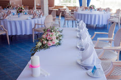 Wedding banquet, small restaurant in a Maritime style, round tables Stock Photos