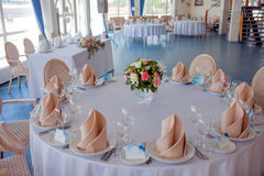 Wedding banquet, small restaurant in a Maritime style, round tables Royalty Free Stock Photos