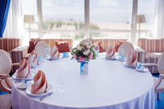 Wedding banquet, small restaurant in a Maritime style, round tables Royalty Free Stock Images