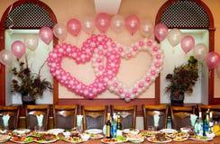 Wedding banquet table. A wedding banquet table - balloons hearts above Stock Photos