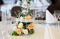 Wedding banquet table restaurant with flowers in birdcage. Shabby chic. Wedding banquet table restaurant with flowers in birdcage Stock Photo