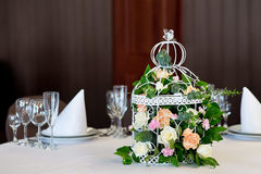Wedding banquet table restaurant with flowers in birdcage. Shabby chic. Wedding banquet table restaurant with flowers in birdcage Royalty Free Stock Photo