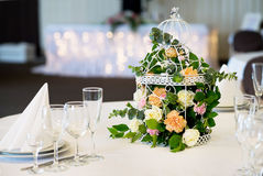 Wedding banquet table restaurant with flowers in birdcage. Shabby chic. Wedding banquet table restaurant with flowers in birdcage Stock Image