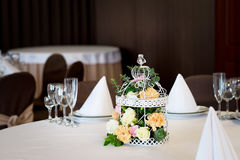 Wedding banquet table restaurant with flowers in birdcage. Shabby chic. Wedding banquet table restaurant with flowers in birdcage Royalty Free Stock Images