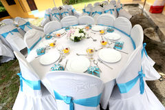 Wedding banquet table setting. Malay wedding banquet table with blue ribbon Stock Photos