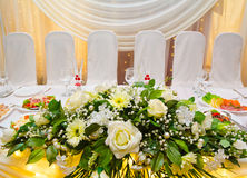 Wedding banquet table white flowers Stock Images