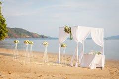Wedding on the beach. White silk wedding tent on a sandy beach Stock Photos