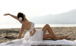 Wedding on the beach. Woman in white clothes sitting on the beach Stock Images