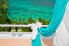 Wedding on the beach . Glasses of champagne. Wedding arch in blu Royalty Free Stock Photos