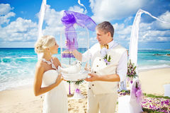 Wedding on the beach. Gorgeous Balinese beach with rich decoration Royalty Free Stock Images