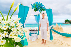Wedding on the beach. The groom waits for the bride under the ar Stock Images