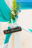 Wedding on the beach . Just married. Wedding arch decorated with Royalty Free Stock Photo