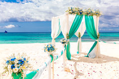 Wedding on the beach . Wedding arch decorated with flowers on tr Royalty Free Stock Image