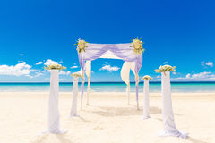 Wedding on the beach . Wedding arch decorated with flowers on tr Stock Photo
