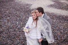 Wedding on the beach in winter Stock Photos