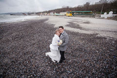 Wedding on the beach in winter Royalty Free Stock Photos
