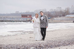 Wedding on the beach in winter Stock Photography