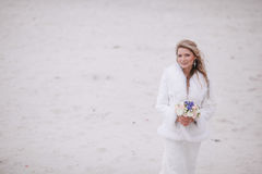 Wedding on the beach in winter. Wedding in winter on the beach Stock Image