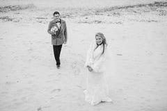Wedding on the beach in winter Stock Photo