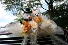 Wedding bear. Red wedding car with bridal bear and roses bouquet Stock Image