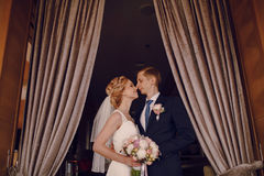 Wedding beautiful blond couple in restaurant Stock Images