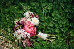 Wedding beautiful bridal bouquet, flowers, pink and white roses,peones, on green grass stock photos