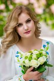 Wedding, beautiful girl with a wedding bouquet royalty free stock image
