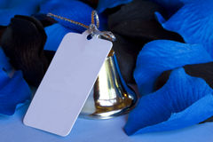 Wedding Bell. A silver wedding bell with a blank card attached by ribbon Royalty Free Stock Photos