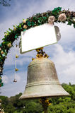 Wedding bell and decorative flowers Royalty Free Stock Photos