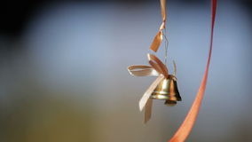 Wedding bell hanging on a ribbon in the wind stock video
