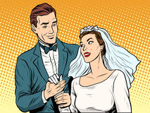 Wedding betrothal engagement groom bride love. Pop art retro style. Couple man and woman in wedding attire. Romance and feelings Royalty Free Stock Images