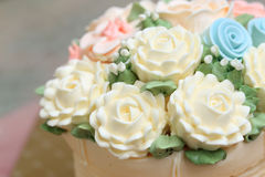 Wedding or birthday cake decorated with flowers made from cream. Royalty Free Stock Photos