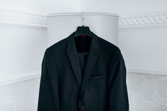 Wedding black suit hangs on hanger Royalty Free Stock Photography